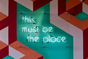Neon Sign saying This Must be the Place